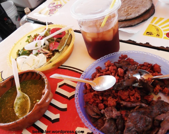 Cecina (salted meat) and longaniza (sausage) at a fair-- with salsa and toppings at hand, of course.