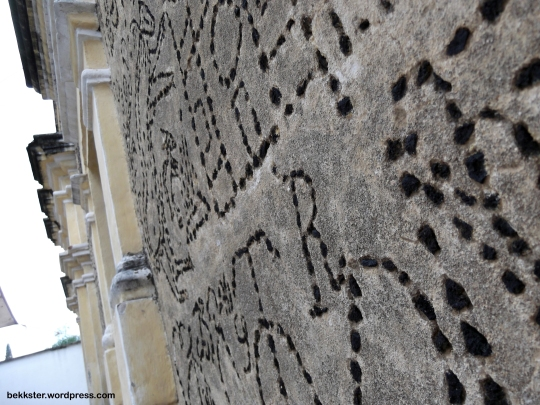 The mural is made with black volcanic rock.
