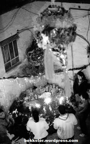A traditional posada, complete with piñata, nacimiento (nativity scene) with paxtle, and luces de bengala (sparklers).