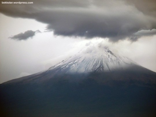 Popocatépetl with what appears to be a snow storm at its peak.