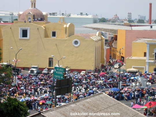 I was lucky enough to watch it from a rooftop, since the streets are packed. Note the people sitting on the church's roof across the street!