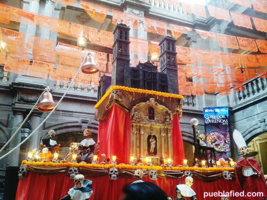 The history of Puebla's cathedral in an ofrenda. All the skeletons are dressed as nuns and monks!